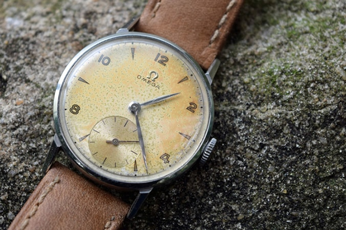 Omega 30T2 watch with a discolored dial